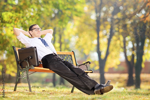 Young businessman taking a break after work