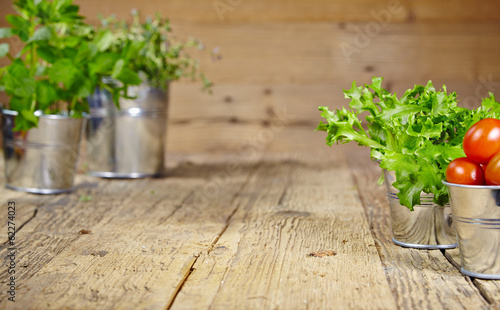Fresh herbs on a rustic table in late day sunlight