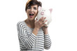 Beautiful happy woman with a piggybank