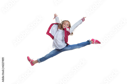 fit healthy young girl doing ballet leap