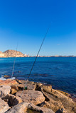 Alicante and san Juan fishing in breakwater at Spain
