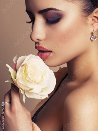 portrait of beautiful brunette with rose