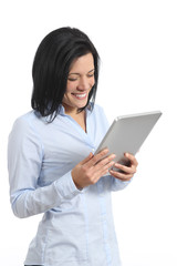 Happy woman reading a tablet reader