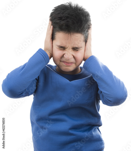 Little boy suffering ear ache isolated on white background