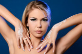 Beautiful woman with bodyart on hands