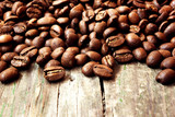 roasted coffee beans on a grunge wooden background