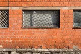 Brick wall with metal window bars