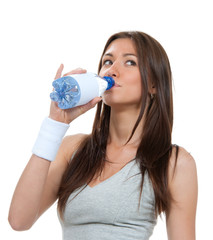 Sporty woman drinking water from clear glass healthy lifestyle w