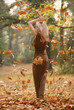 Outdoor in fall, sexy, slim woman, long brown dress