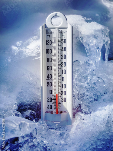 Ice cold thermometer in snow - 62279018