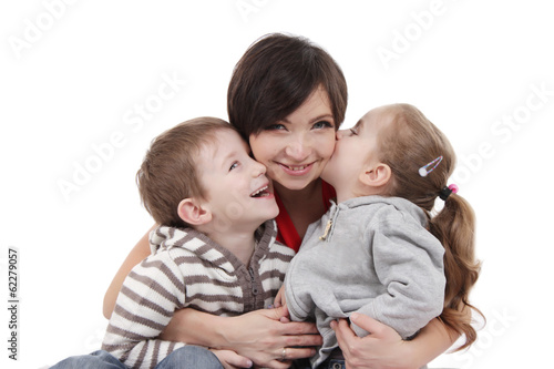 Mother hugging two children over white