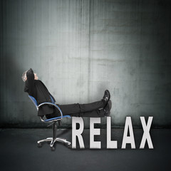 Businessman relaxing in office chair