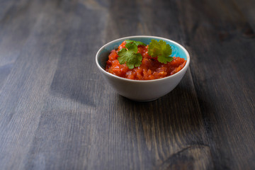 Salsa sauce on wood table