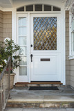 White front door of upscale beige home
