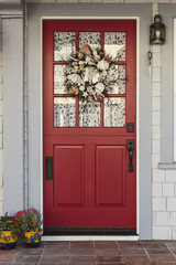 Classic red door to a white home