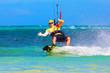 young smiing  kitesurfer on sea background Extreme Sport Kitesur