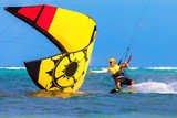 young smiing  kitesurfer on sea background Extreme Sport Kitesur