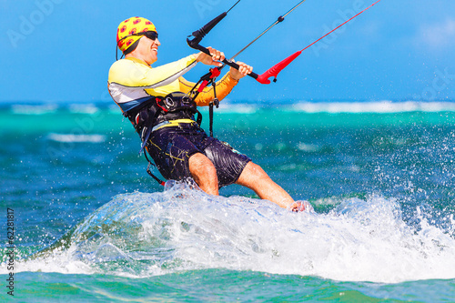 young  kitesurfer on sea background Extreme Sport Kitesur