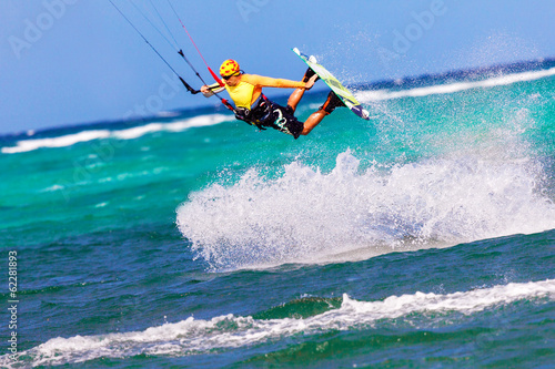 jumping kitesurfer on sea background Extreme Sport Kitesurfing