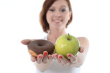sport Woman with Apple and Chocolate Donut in Hands to choose