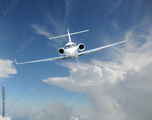 Private jet airplane in the sky