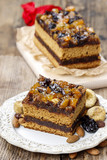 Delicious layer gingerbread cake decorated with dried fruits