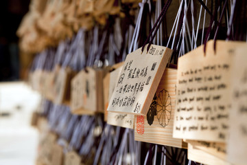 Wooden prayer tablets hanging inside a Japanese temple in Tokyo