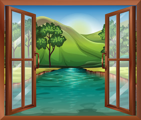 A window near the flowing river