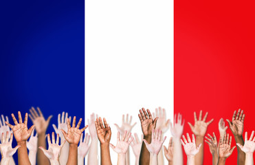 Multi-Ethnic Hands With The Flag Of France