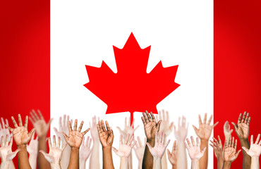 Multi-Ethnic Hands With The Flag Of Canada