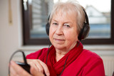 female senior listening music