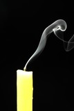 candle with abstract smoke on black background