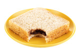 Bitten sandwich with chocolate on plate isolated on white