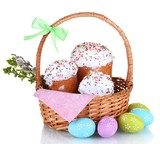 Beautiful Easter cakes in basket, colorful eggs and