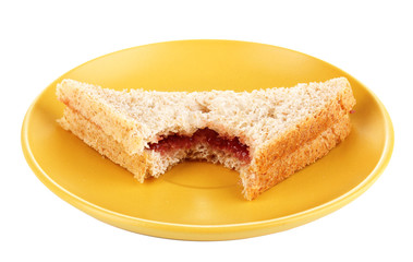 Bitten sandwich with jam on plate isolated on white