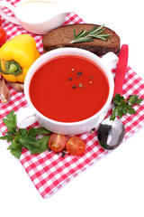 Tasty tomato soup and vegetables, isolated on white