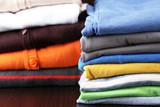 Stack of colorful clothes, on dark background