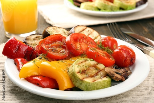 Delicious grilled vegetables on plate on table close-up