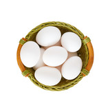 White eggs in basket isolated on white background