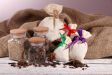Sacks and glass jars full with spices,