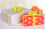 Gift boxes on table on light background