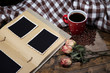 Composition with coffee cup, decorative hearts, plaid, and
