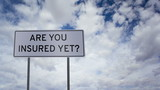 Sign Insured Yet Clouds Timelapse