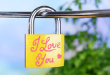 Padlock on bright background