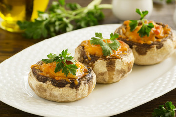 Mushrooms baked with cheddar cheese.