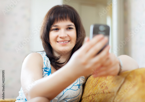 ordinary woman reads SMS