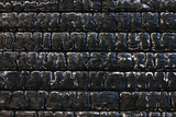 Black burnt wooden wall.  Grunge background.