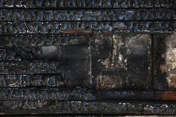 Black burnt wooden wall.  Grunge background.