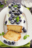 Lemon cake with blueberry glaze.
