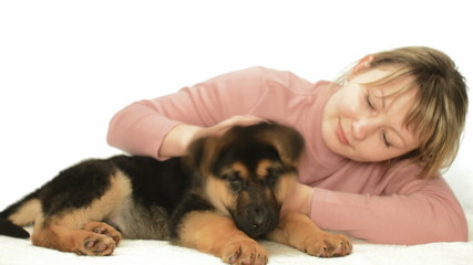 cute young woman and puppy